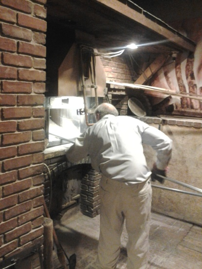 Gerard preparing to load the oven for firing.